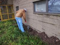 Scott mulching by the building