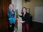 Holiday party chairwoman Susan Sanders, a Southern Methodist University alumna, stands at the door with party hostess Susan Krall, an OU Theta.