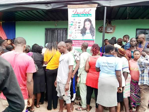 Wife Dumps Charm In Front Of The Shop Of Lady Who Snatched Her Abroad Husband (Photos)