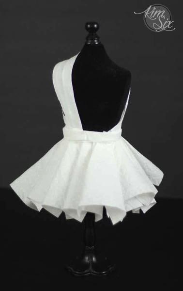 Back side of paper white dress