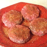 The seasoned burgers, ready for the grill-off.