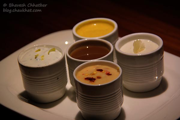 Close-up of 5 dips served with Cigar Rolls — Parma, Chili Mustard, Cheese Chipotle, Wine Gravy, Creme de Chive Lemon