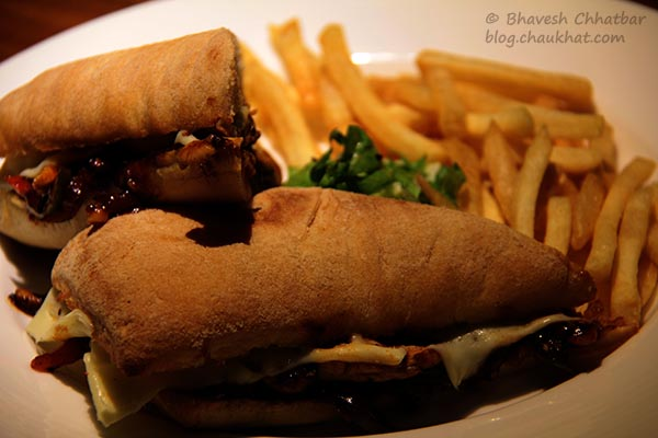 Close-up of Barbeque Chicken Sandwich with French Fries, served at Toss Sports Lounge Koregaon Park