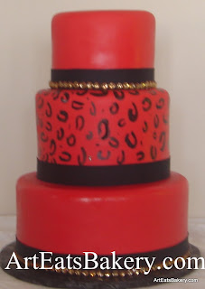 Three tier red and black fondant lady's cheeta print and gold rhinestones unique creative birthday cake