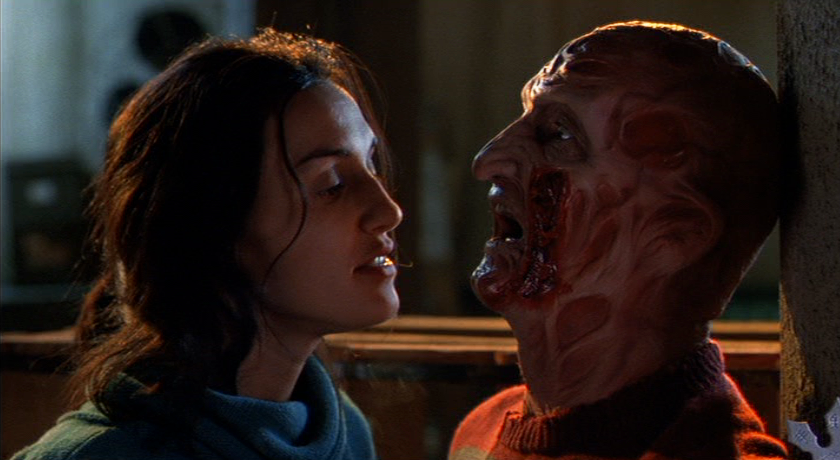 Maggie (Lisa Zane) stabs Freddy with his own glove.
