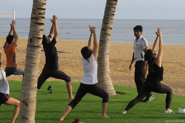 Yoga by the beach, under the watchful eye of an instructor.