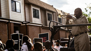 On May 13, 2021, trumpet player Kenneth Taylor played as protesters marched in honor of the lives of 11 people who died when the city bombed MOVE's West Philly house in 1985 KIMBERLY PAYNTER / WHYY Headshot_MalcolmBurnley