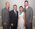 Honorary co-chair Roger Staubach, Brad Berkley, luncheon chairwoman Lindy Berkley and honorary co-chair Troy Aikman.