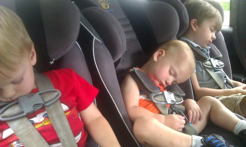 Three boys sleeping in the car
