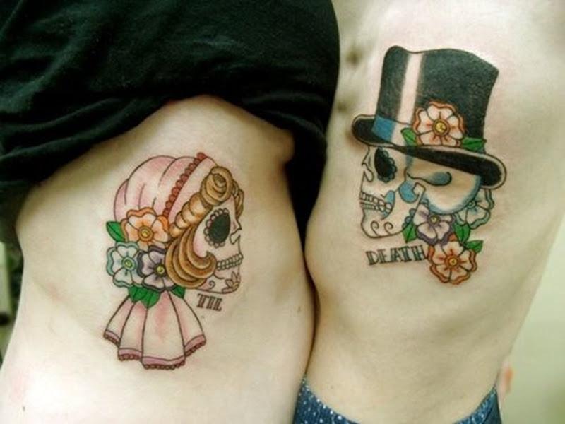 açcar_crnios_casal_tatuagem_do_corpo