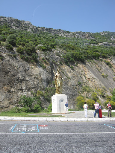 Statue of Mother Mary, guiding the way to her house. Turkey