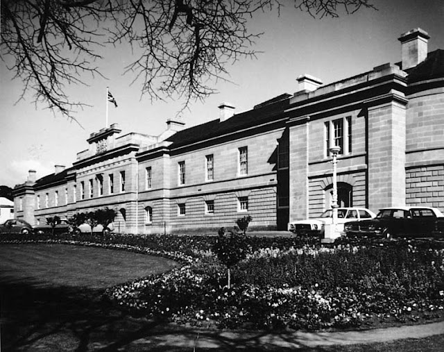 Photograph - View of Parliament House facade, with flower garden in the foreground, Hobart