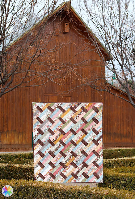 Fast Track quilt pattern by Andy of A Bright Corner - perfect for using jelly roll or layer cake precut fabric