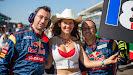 Scuderia Toro Rosso mechanics with a grid girl