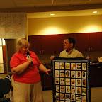 Alice Hix donates quilt to Robert Gleaves
