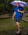 Mark Brown singing in the rain, Mulu 2013 | photo © Andy Harp