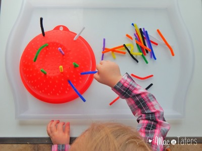 Using pipe cleaners and a colander, you can set up the perfect color themed invitation to play that not only works to promote color learning, but also fine motor skills.
