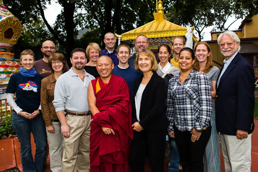 Geshe Tenley with Sean Gonzalez (immediate left) and Debra Thornberg (immediate right) and team leaders of the event crew, Kurkulla Center, October 2012. Over 200 volunteers helped make the visit of His Holiness the Dalai Lama to Kurukulla Center a great experience for everyone. Photo by Kadri Kurgun.