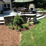 Outdoor Room With Bluestone  and Fieldstone Seat Wall