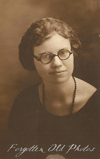 Gal with dark glasses and a necklace DL Antiques