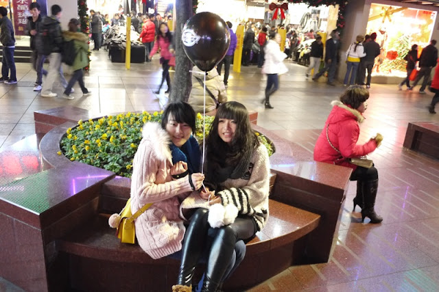 two Shanghainese girls holding a Dickies balloon