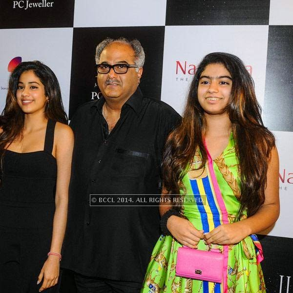 Boney Kapoor with his daughters Khushi and Jhanvi on Day 3 of India International Jewellery Week (IIJW), 2014, held at Grand Hyatt, in Mumbai.<br />