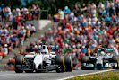 Valterri Bottas, Williams FW36 Mercedes, leads Lewis Hamilton, Mercedes F1 W05 Hybrid