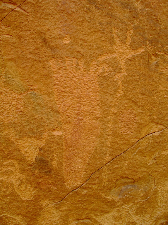 Petroglyphs with faint pigment