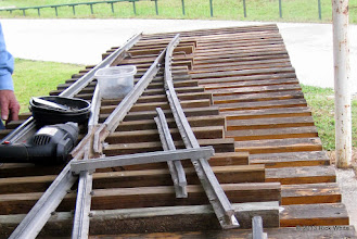 Photo: Track gauge helps smooth the curve.   Bill Howe builds switches for two center tracks at the engine barn.    HALS Public Run Day 2013-0921 RPW