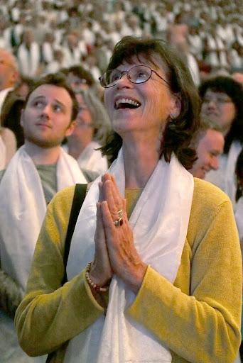 Audience member listening to His Holiness the Dalai Lama, Veterans Memorial Coliseum, Portland, Oregon, U.S., May 11, 2013. Photo by Kurt Smith.