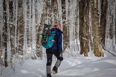 Girl snowshoeing with backpack