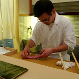 the chef at Sukiyabashi Jiro preparing my Ootoro cut in Roppongi, Tokyo, Japan