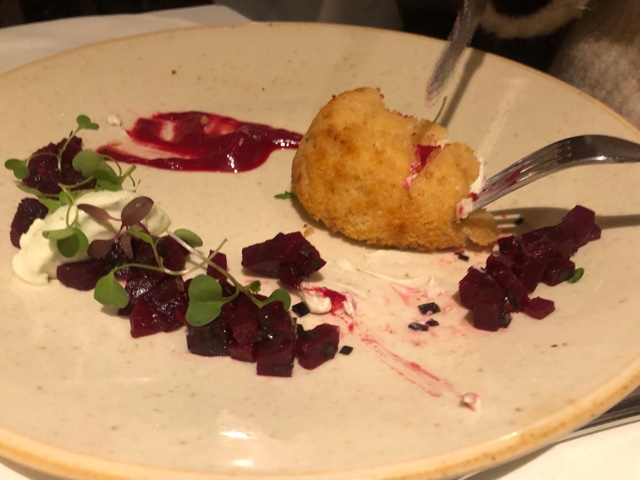 Twice baked goats cheese soufflé , beetroot coulis