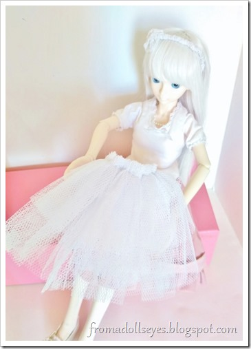 Our white haired bjd narrator (Hikaru) looking at her new petticoat.
