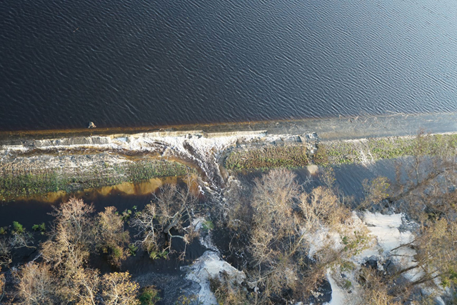 Aerial view of coal byproduct spilling over Sutton cooling lake into the Cape Fear River after flooding from Hurricane Forence. Photo: Duke Energy / Bloomberg