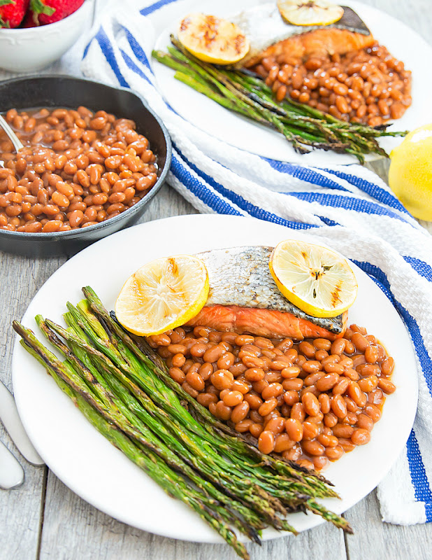 photo of two plates of brown sugar glazed salmon with roasted asparagus and baked beans
