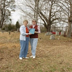Hilda Barnes presents a copy of her book, Middle Tennessee Gleaves, to Donna Ferrell, President of the West Wilson County Historical Society.