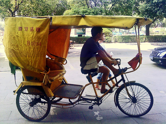 cycle rickshaw driver on road
