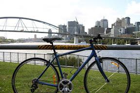 My bike with the Victoria Bridge and downtown Brisbane