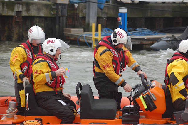 Poole's volunteer lifeboat crew prepare to launch to supervise the Bath Tub Race - 1st January 2016.  Photo credit: Dave Riley