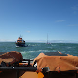 Yarmouth ALB starting to tow a yacht with engine and steering failure towards the Solent on 11 May 2013. Taken from Poole ALB. Photo: RNLI/Poole Neil Ceconi