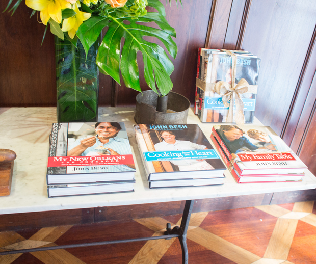photo of a table topped with cookbooks by John Besh