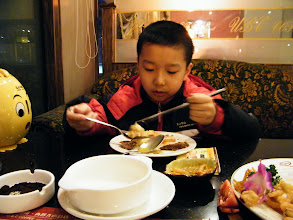 Photo: long time planned dinner ate before lunar Spring festival eve. the proudest dad, benzrad 朱子卓 brought his best beloved son, warrenzh 朱楚甲, dined out in Shangdao cafe after shower. we ordered more than we can eat, but warrenzh love the food and the restaurant. OMG, 2012 completed so rich! here warrenzh enjoyed beef.