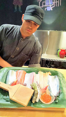 Chef Ryan Roadhouse explains the various seafood in his display of the sushi to come, fresh from being picked up at the airport less than 24 hours before and sourced from Tsukiji and Fukuoka Municipal