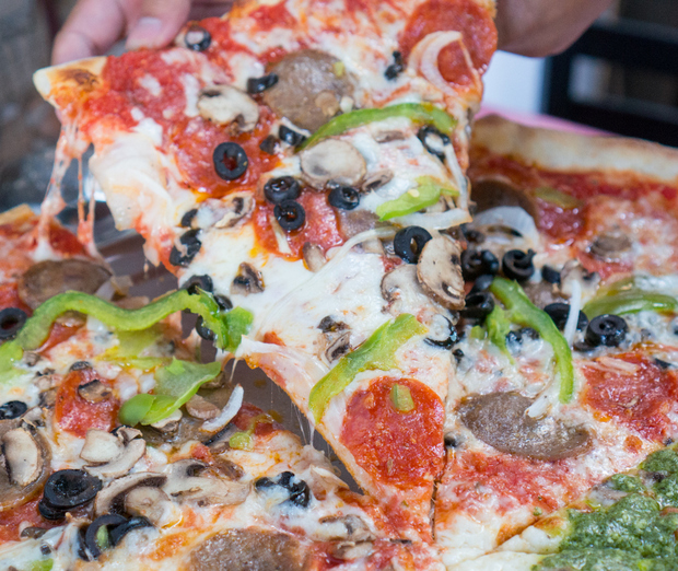close-up photo of a slice of Bronx Deluxe