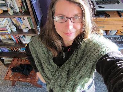 Deva wearing the gray-green scarf around her shoulders.