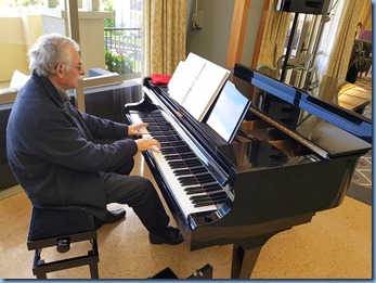 Claude Moffat playing the K. Kawai grand piano at Knightsbridge Village.