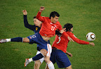 Chile's midfielder Arturo Vidal (L) vies with Spain's defender Alvaro Arbeloa (C) and Spain's defender Gerard Pique during their Group H first round 2010 World Cup football match on June 25, 2010 at Loftus Verfeld stadium in Tshwane/Pretoria. NO PUSH TO MOBILE / MOBILE USE SOLELY WITHIN EDITORIAL ARTICLE  AFP PHOTO / HOANG DINH NAM