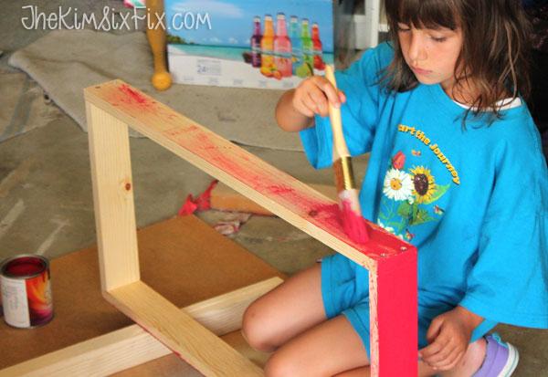 Painting cornhole board
