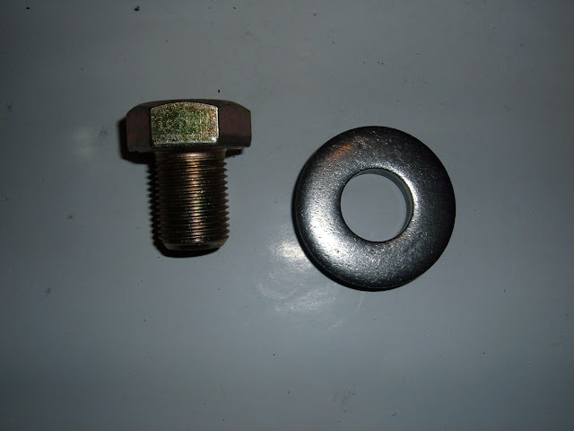 Balancer/damper bolt and washer, fits all 1957-66 nailheads and some 1955-56 engines. 3/4x16 thread. 12.00 for set new. Must be tightened to 220 lbs!
